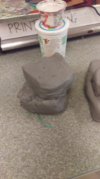 2 pieces of clay stacked and ready to be slammed
